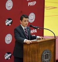 Declamations 8th grade winner addresses student body at podium