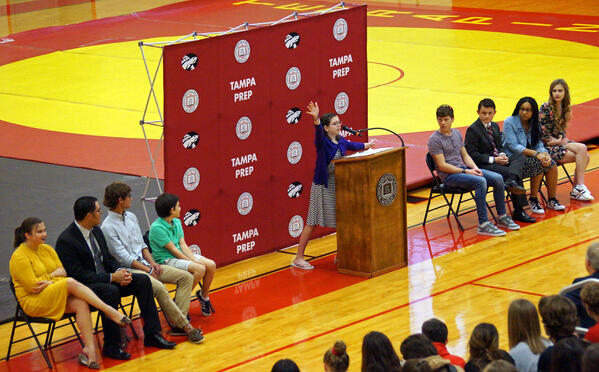 Declamations middle school winner speaks in front of assembly