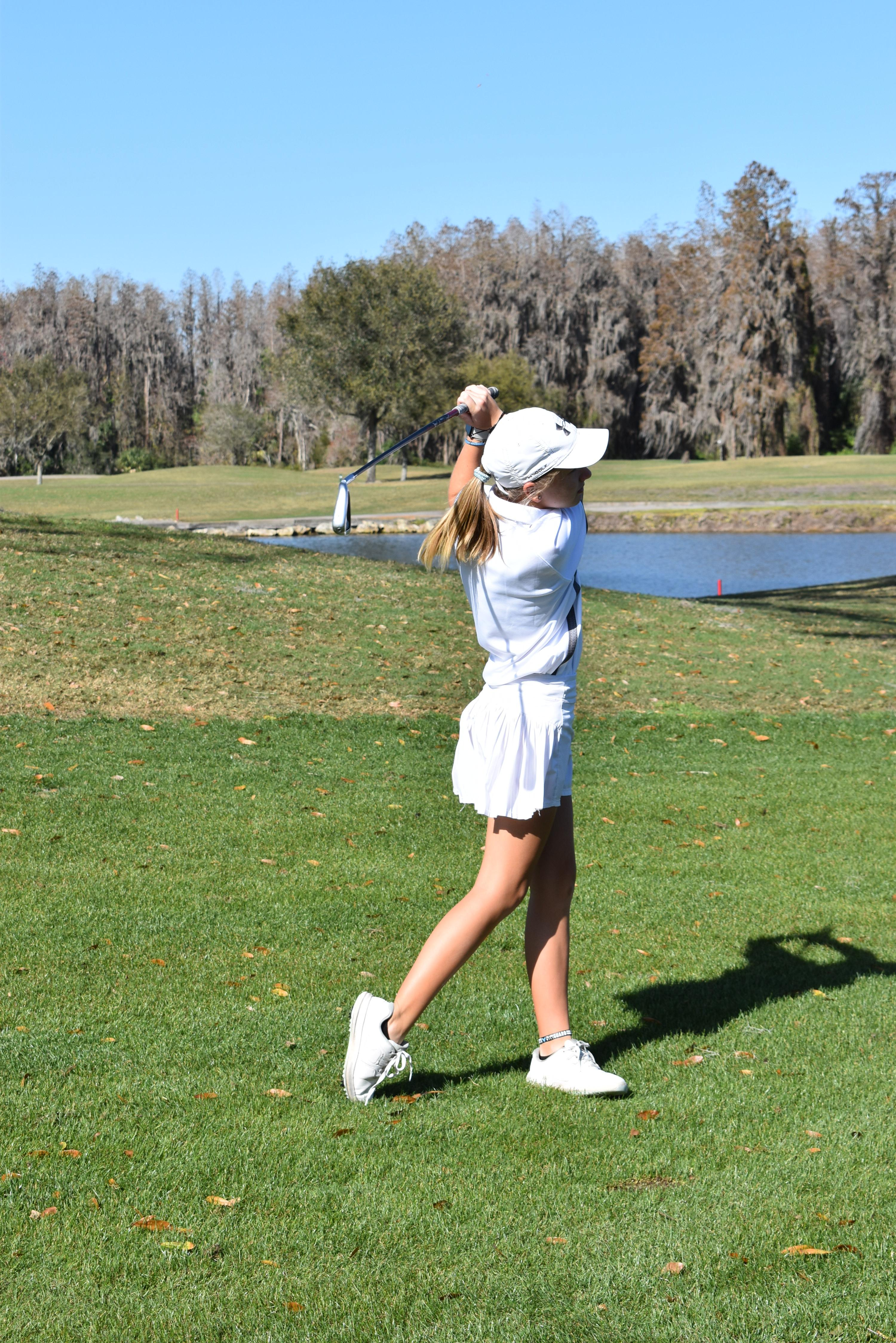 Young girl swinging her club at Saddlebrook Resort for Tampa Prep Golf Outing