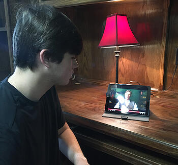 Steve Curtis watching screen writing class on ipad